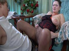 Mature Emily found Benjamin with his hard-on popping out of his pants, so she decided to take advantage of it. She blew and stroked the rod before treating the boy to a legjob through her glossy control top tights. In a short time the boy was ready for more, so he positioned the curvy milf and entered her eager mommy beaver from behind. See if this lusty chubby cougar could drain that young dick!