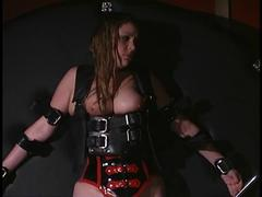 Thick woman bound with leather restraints