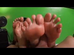 two girls gives nice footjob
