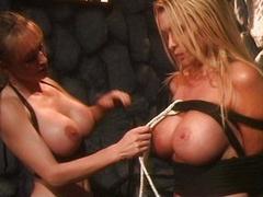Lesbian mistress dominates blonde