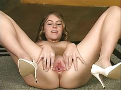 Brunette strips naked by stairs