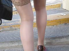 Chick in tan stockings going upstairs