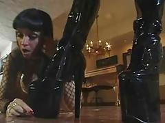Mistress Taylor Wane straps on slave