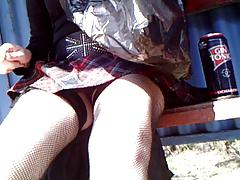 Girl in fishnet stockings changes her soes