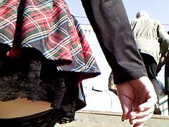 Plaid skirt and fishnet stockings