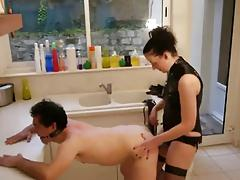Milf uses a strapon to demonstrate her domination