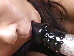 Beautiful Japanese girl sucking vibrator