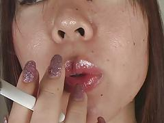 Close-up of Japanese girl smoking