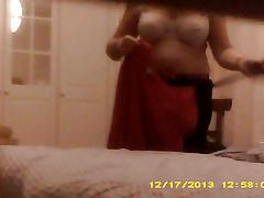 Mature wife tries on clothes and strips