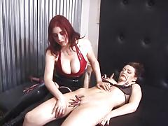 Dominatrix redhead torments her sexy slave's shaved pussy