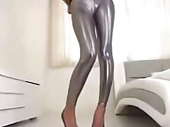 stunning girl in shiny silver leggings