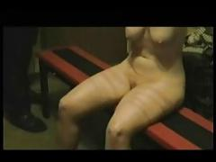 Mad husband whipping the legs and bOObs of the your wife.