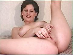 British slut Kelly plays with herself on the bed