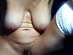 Milf with natural tits plays with them and hairy crotch