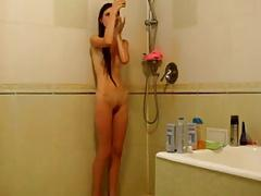 Skinny girl under the shower