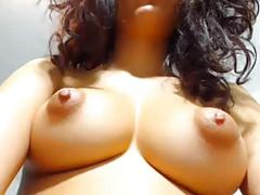 Spreads and fingers her shaven wet pussy