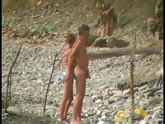 Voyeur on public beach. Blowjobs