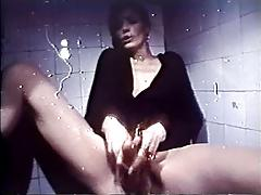 Lady Choking Snake On Toilet