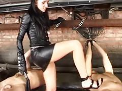 mistress dominates 2 slaves