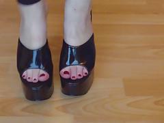 Ballbusting mistress in black platform mules