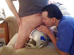 sucking cock on top of a lions helmet