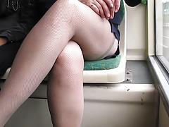 Girl in fishnet stockings in a bus