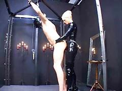 Domme, he's tied, strapon