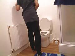 Chambermaid in her bathroom wearing high heels very horny