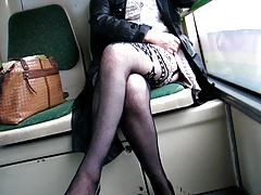 Chick flashing fashion stockings in a bus
