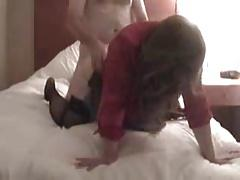 Wife with bull and hubby in a hotel room