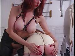 Red head in white leather gets her ass spanked