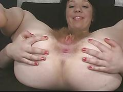 Sexy brunette with tight pussy plays with herself on couch