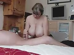 Hot MILF with HUGE tits strokes an old cock.