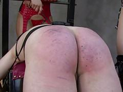 Two mistress spank slave