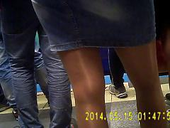 Shiny tan pantyhose girl in metro